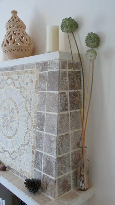 Mosaic tiled fireplace in living area