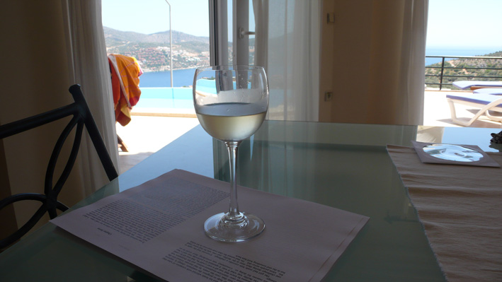 Chilled wine and manuscript in open plan living area, with sea views