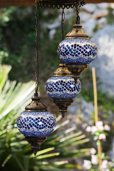 Traditional Turkish lanterns hanging in Ottoman seating area