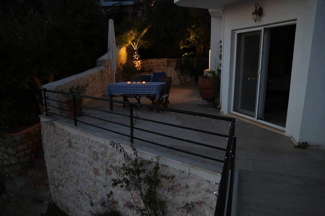 Private terrace and table for al fresco dining, by candlelight