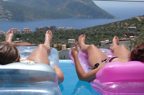 Relax on lilos in private infinity pool with views of Kalkan harbour