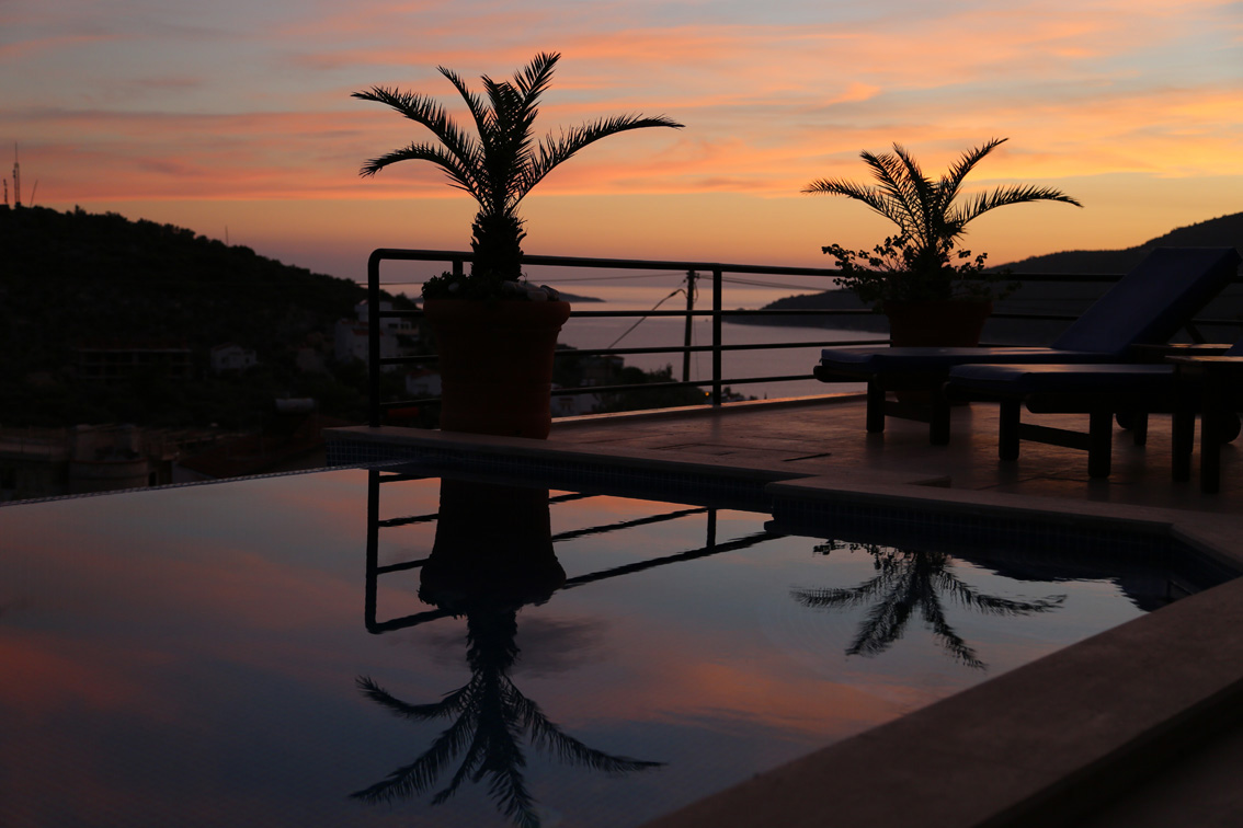 Private infinity pool at sunset with views to sea and islands