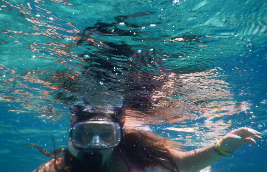 Girl underwater with mask and snorkel